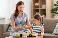 Pregnant mother and daughter with toy blocks royalty free stock photos
