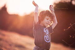 Childhood  - Playing on the filed in sunset Stock Image