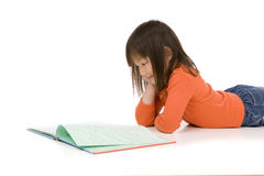 Childhood Reading. A young asian girl drawing a picture. On white Royalty Free Stock Image