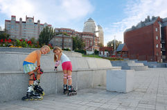 childhood on rollerblades in the urban park Stock Images