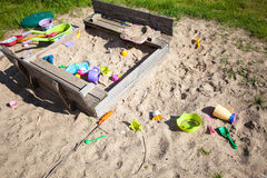 Childhood. Sandpit sandbox with toys on playground. Royalty Free Stock Image