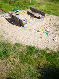 Childhood. Sandpit sandbox with toys on playground. Stock Image
