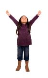 Childhood Series (Success). A young girl reaches toward the sky...success yes Royalty Free Stock Image