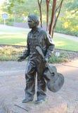 Elvis Presley Childhood Statue. Childhood statues of Elvis Presley holding a guitar in  Tupelo, Mississippi Stock Image