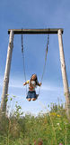 Childhood and swing. Little lady, childhood and swing Royalty Free Stock Images