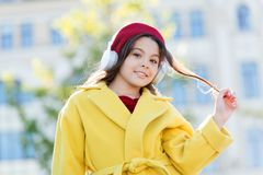 Childhood and teenage music taste. Little girl listening music enjoy favorite song. Girl with headphones urban. Background. Child girl french style outfit stock photo