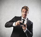 Childish adult. Young businessman playing a videogame Stock Photography
