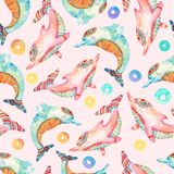 Childish animals in cartoon style. Watercolor lovely dolphins seamless pattern on background with rings. Childish animals in cartoon style. Hand painted cute royalty free illustration