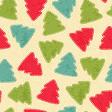 Childish Christmas seamless pattern with Christmas trees. Childish Christmas seamless pattern with colorful Christmas trees. Hand-sewn style elements with white Stock Photos