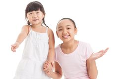 Childish emotions. Two girls looking amused or excited about something off the screen Stock Photography