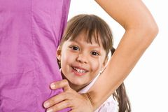 Childish face. Face of happy child looking through her mother arm bent in elbow over white background Stock Image
