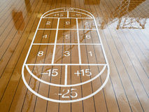 Childish game hopscotch. Painted on wooden wet floor Royalty Free Stock Image