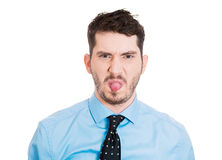 Childish guy sticking tongue out Stock Images