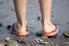 Childish legs on the beach Royalty Free Stock Image