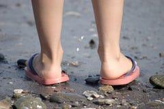 Childish legs on the beach Royalty Free Stock Image