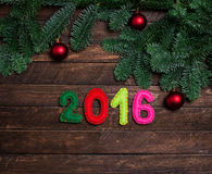 Childish New year background with christmas toy from felt on dar Stock Photography