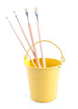 Childish pail with the paintbrishes Royalty Free Stock Photos