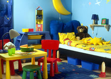 Childish room. With table and bed royalty free stock photo