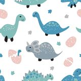 Childish seamless pattern with cute dinosaurs Royalty Free Stock Photography