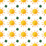 Childish seamless pattern with suns and clovers. Cute smiling sun clover. Good Luck. Green leaves. St.Patrick `s Day. Hand painted Royalty Free Stock Photography