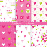 Childish seamless patterns with abstract graphic floral and hear Royalty Free Stock Images