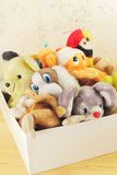 Childish soft toys. Old children's stuffed animals in a box Royalty Free Stock Photos
