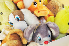 Childish soft toys. Old children's stuffed animals in a box Royalty Free Stock Photo