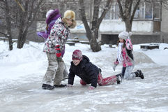 Childish sports on the street in the winter. Stock Photos