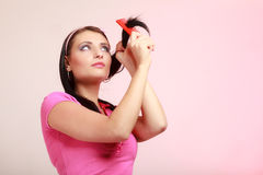 Childish woman infantile girl combing hair. Longing for childhood. Stock Image