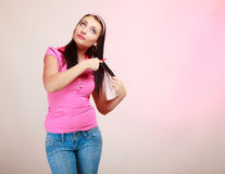 Childish woman infantile girl combing hair. Longing for childhood. Stock Photography