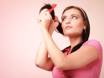 Childish woman infantile girl combing hair. Longing for childhood. Royalty Free Stock Images