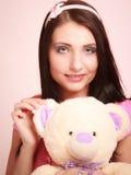 Childish woman infantile girl hugging teddy bear Royalty Free Stock Image