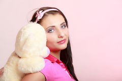 Childish woman infantile girl hugging teddy bear Stock Images