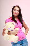 Childish woman infantile girl hugging teddy bear Royalty Free Stock Photos