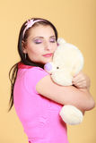 Childish woman infantile girl hugging teddy bear Stock Photography