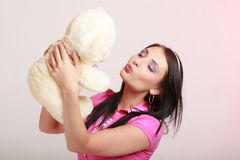 Childish woman infantile girl kissing teddy bear Royalty Free Stock Photo