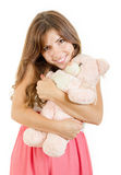 Childish young woman hugging teddy bear Stock Photo