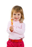 Childl with a bright lollipop Royalty Free Stock Photography