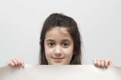 Childl holding a blank sign Royalty Free Stock Photography