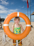 Childl with  life buoy at coast. Royalty Free Stock Images