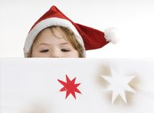 Childlike curiosity. Portrait of little girl in santa's hat Stock Photography