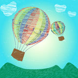 Childlike drawing hot air balloons. Set on the sky over the mountine invitation card can be used for holiday cards, wedding invitation, postcard, flayer, banner Stock Images