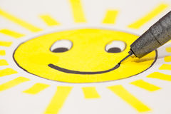 Sun. A childlike drawing of the sun with a smiley face Stock Photo