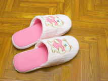 Childlike slippers on parquet. Bear with heart Royalty Free Stock Photography