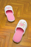 Childlike slippers on parquet, bear with heart Royalty Free Stock Photo