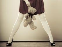 Childlike woman with teddy bear toy Stock Photos