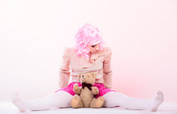 Childlike woman with teddy bear toy Stock Images