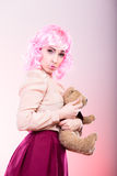 Childlike woman with teddy bear toy Royalty Free Stock Photo