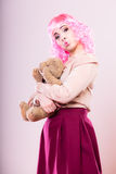 Childlike woman with teddy bear toy Stock Photo