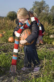 Childr on pumpkin field Royalty Free Stock Photos